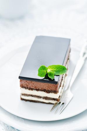 tinting: Opera cake on a white background. tinting. selective focus Stock Photo