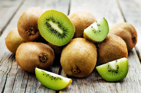 kiwi on white wood background. tinting. selective focus Фото со стока - 37091641