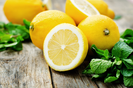 lemons and mint on a dark wood background. tinting. selective focus Фото со стока - 37091683