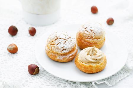 praline: profiteroles with cream with praline on a white background Stock Photo