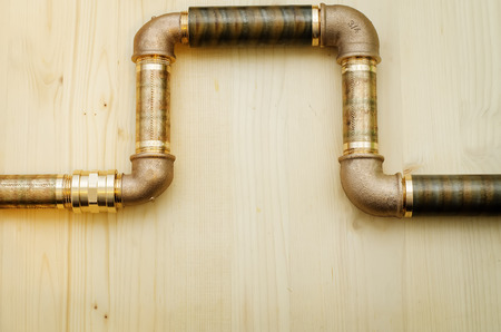 tools plumbing on a light woody background photo