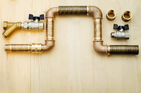 tools plumbing on a light woody background
