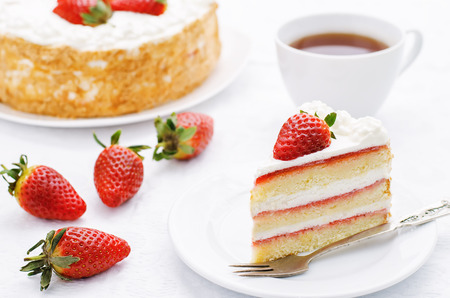 cake with cream and strawberries on a white background. tinting. selective focus