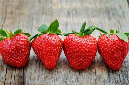 strawberry: strawberry on dark wood background. tinting. selective focus