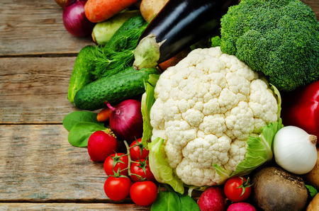 vegetables. tomatoes, potatoes, eggplant, zucchini, onion, carrot, radish, cucumber, tomato, peppers, spinach, cauliflower, broccoli, beets, parsley. the toning. selective focus Stock Photo