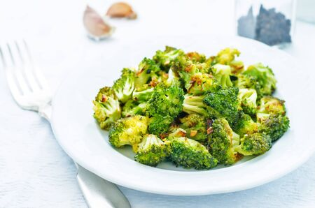 roasted broccoli with garlic on a white background. the toning. selective focus