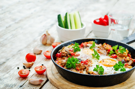 jewish food: fried eggs with peppers, tomatoes, quinoa and mushrooms