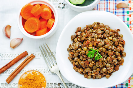 spicy curry cinnamon green lentils on a white background