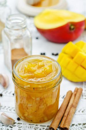 chutney: mango chutney on a white background. the toning. selective focus Stock Photo