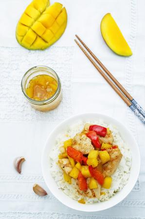 stir fry: mango chicken stir fry with rice Stock Photo