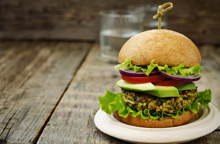 spicy vegan curry burger with millet, chickpeas and herbs