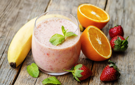 smoothie with strawberries, banana and orange. the toning. selective focus