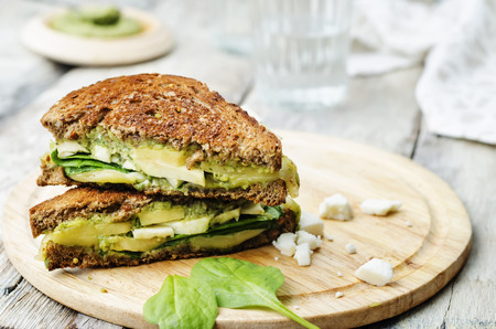 sandwich: grilled rye sandwiches with cheese, spinach, pesto, avocado and goat cheese