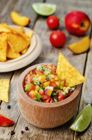 peach salsa on a dark wood background Imagens - 40821954