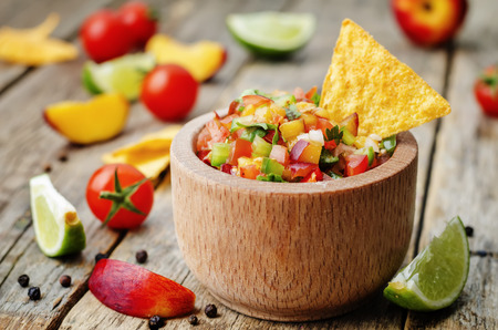 peach salsa on a dark wood background Stock Photo