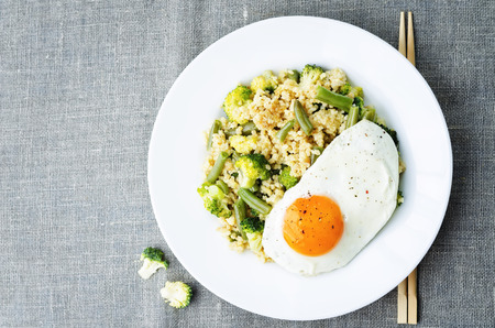stir fried: stir fried millet with broccoli, green beans and fried egg