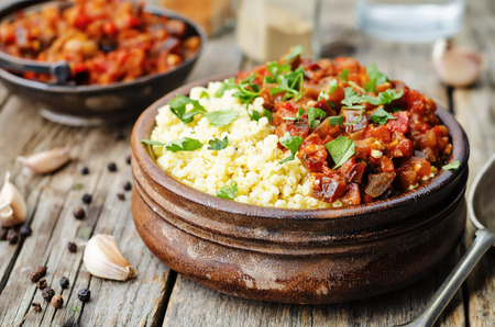 vegetarian cuisine: buttered millet with tomato eggplant curry Stock Photo