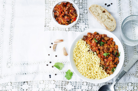 buttered: buttered millet with tomato eggplant curry Stock Photo
