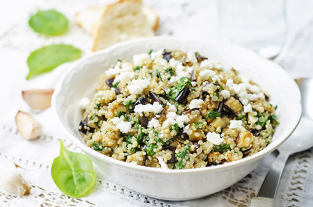quinoa spinach eggplant feta salad on a white background. the toning. selective focus Standard-Bild