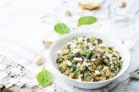 spinach salad: quinoa spinach eggplant feta salad on a white background. the toning. selective focus Stock Photo