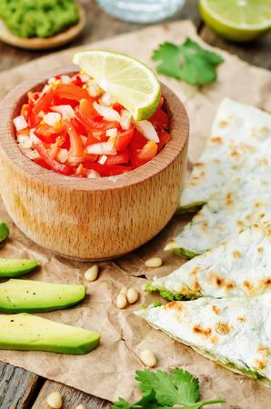gallo: tomato salsa, Pico de Gallo, with cilantro pesto quesadilla. the toning. selective focus Stock Photo