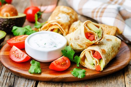 egg roll: avocado tomato egg roll with cilantro sour dip. the toning. selective focus