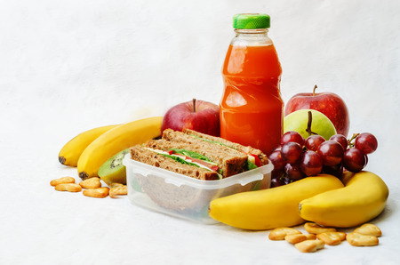 school lunch with a sandwich, fresh fruits, crackers and juice Stock Photo