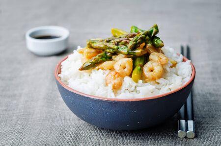 sauce dish: asparagus shrimp stir fry with rice Stock Photo