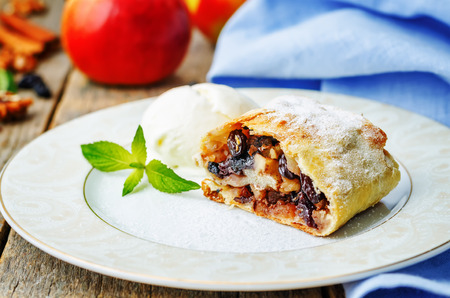 strudel: Apple strudel with nuts and raisins Stock Photo