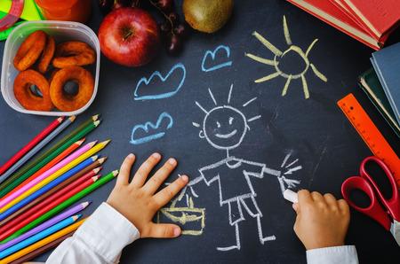 writing: child hands writing on a blackboard Stock Photo