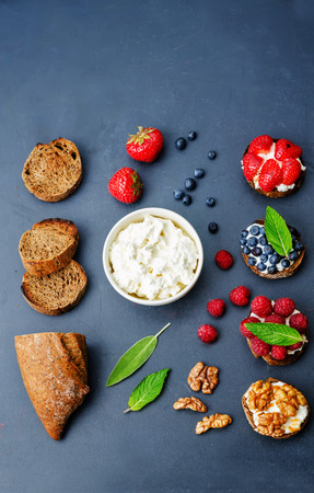 with fillings: ricotta and crostini appetizers with fillings on a black background Stock Photo