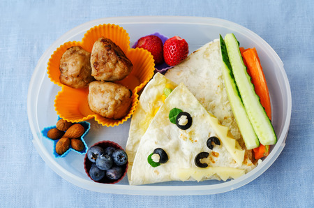 kids meal: school lunch box for kids with food in the form of funny faces Stock Photo