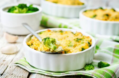 cheddar cheese: millet casserole with broccoli and cheese. the toning. selective focus