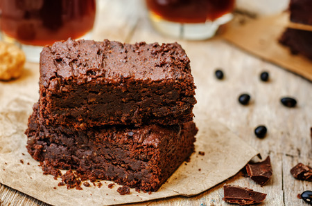 vegan food: black bean brownies on a dark wood background. the toning. selective focus