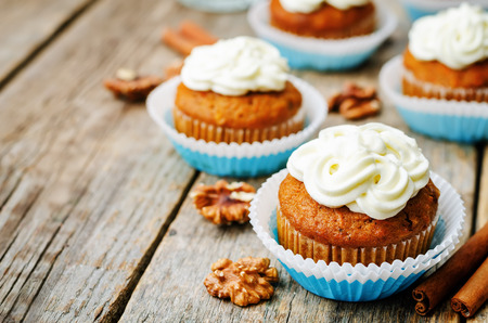 carrot cakes: carrot cupcake on a dark wood background. the toning. selective focus