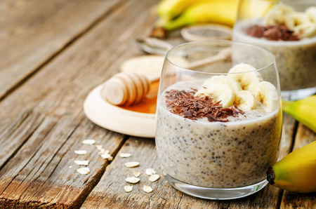 overnight banana oats quinoa Chia seed pudding decorated with banana and chocolate. the toning. selective focus