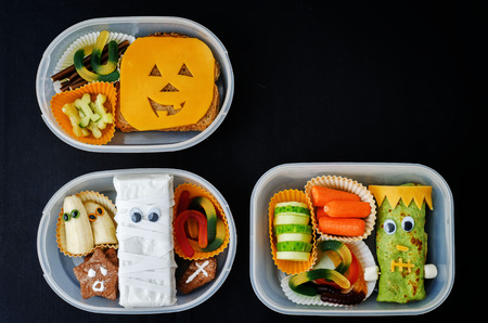 lunch: lunch boxes for children in the form of monsters for Halloween. the toning. selective focus Stock Photo