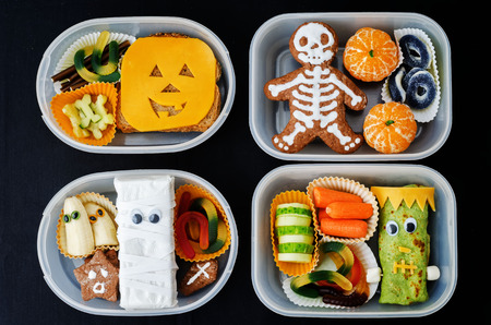 lunch boxes for children in the form of monsters for Halloween. the toning. selective focus Archivio Fotografico