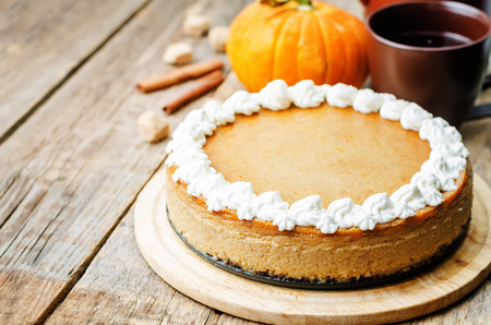 pumpkin pie: pumpkin cheesecake decorated with whipped cream. the toning. selective focus