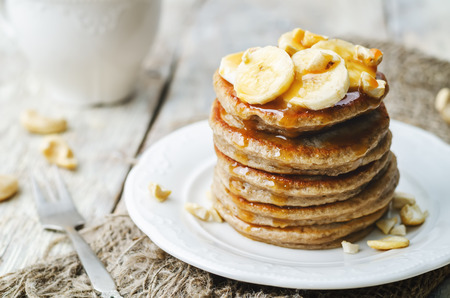 banana cashew pancakes with bananas and salted caramel sauce. the toning. selective focus 스톡 콘텐츠