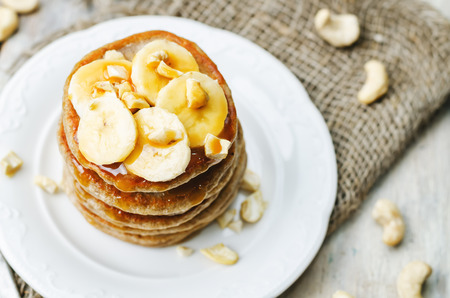 banana: banana cashew pancakes with bananas and salted caramel sauce. the toning. selective focus Stock Photo