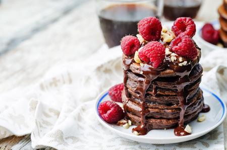 chocolate pancake with bananas, raspberries, nuts and chocolate sauce 스톡 콘텐츠