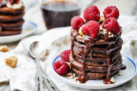 chocolate pancake with bananas, raspberries, nuts and chocolate sauce 스톡 콘텐츠