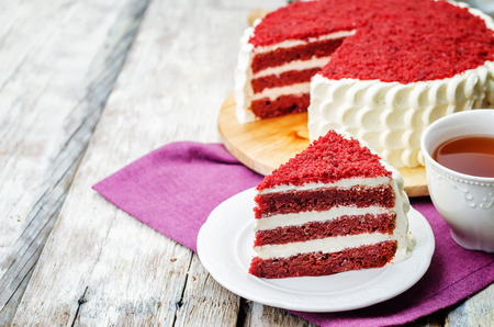 Red velvet cake on a white wood background