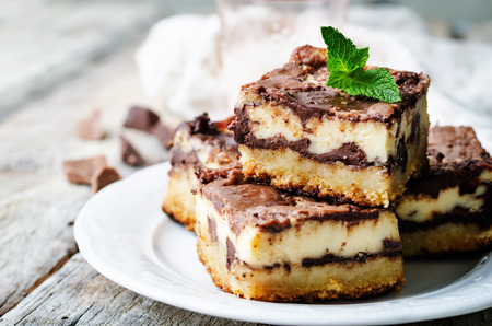 chocolate cream cheese bars on a white background