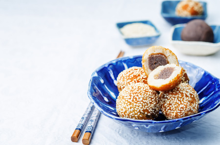 Chinese sesame balls with sweet red bean paste on a white background. toning. selective focus 스톡 콘텐츠