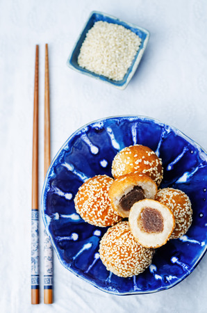 free dish: Chinese sesame balls with sweet red bean paste on a white background. toning. selective focus Stock Photo