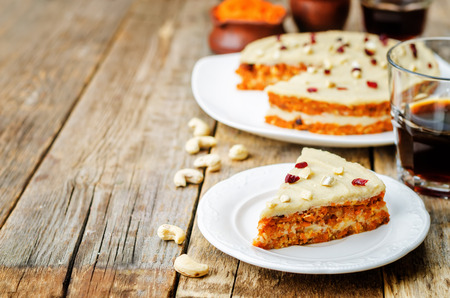 raw vegan carrot cake with cashew cream and dried cranberries. toning. selective focus Stock Photo