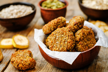 cookies: oats pumpkin and sunflower seeds banana cookies. toning. selective focus Stock Photo