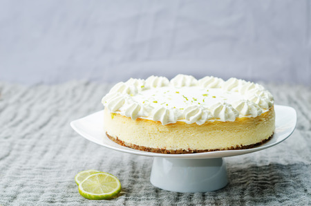 cake on plate: lime cheesecake on a white wood background. toning. selective focus